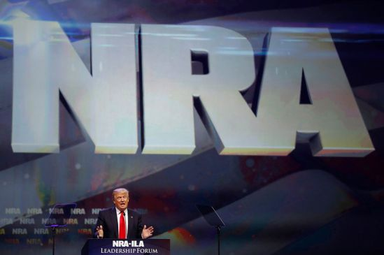 Trump . Donald Trump addresses the National Rifle Association's annual convention, May 20 in Louisville, Ky. Pic by Aaron P. Bernstein.Reuters